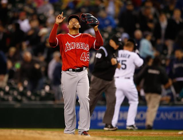 SEATTLE, WA - APRIL 09: Closing pitcher Ernesto Frieri #49 of the Los Angeles Angels of Anaheim points skyward after retiring Kyle Seager #15 of the Seattle Mariners for the final out in a 2-0 defeat at Safeco Field on April 9, 2014 in Seattle, Washington. (Photo by Otto Greule Jr/Getty Images)