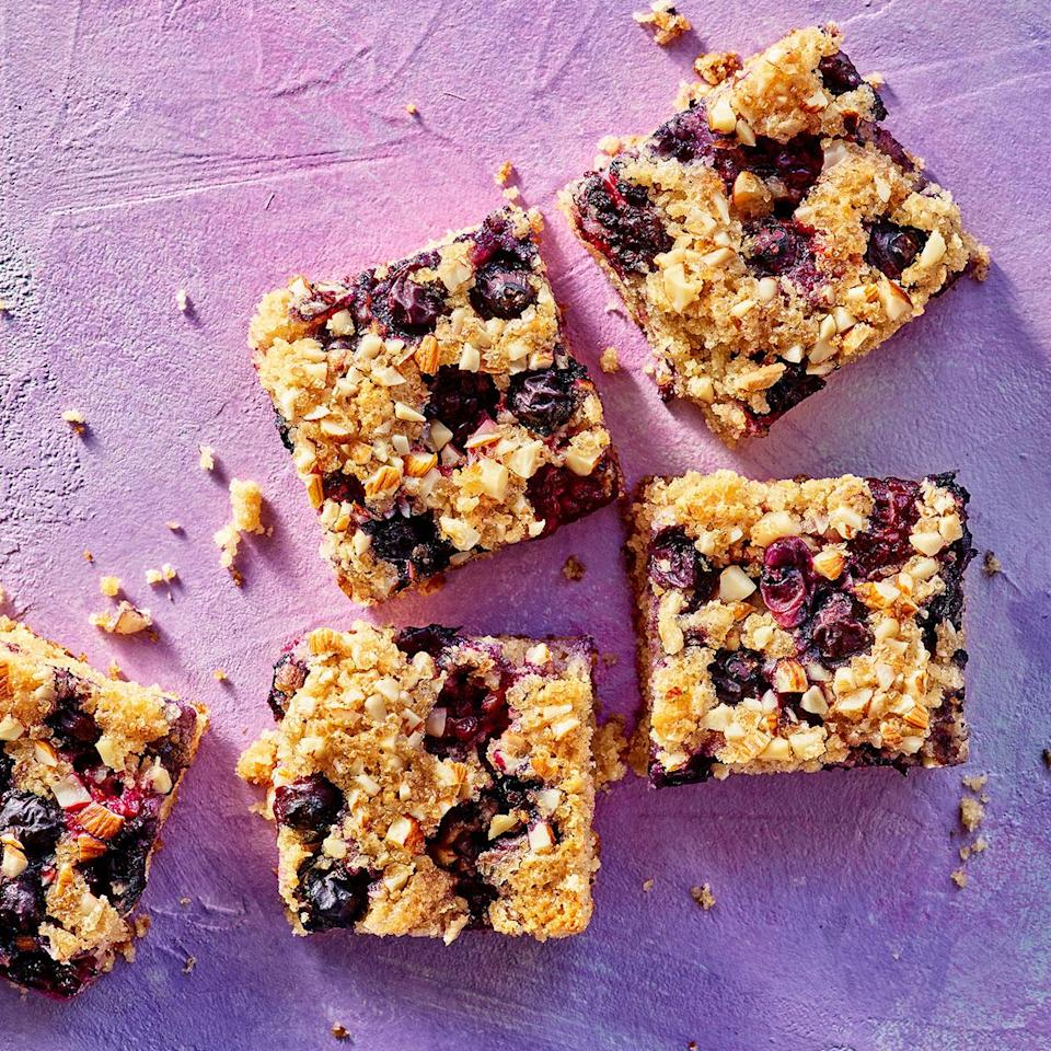 <p>These incredibly easy-to-make cake bars get a touch of sparkle and crunch from a sprinkle of turbinado sugar over the top. If you use frozen berries, thaw and pat them dry before topping the batter with them.</p>