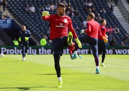 Britain Football Soccer - Scotland v England - 2018 World Cup Qualifying European Zone - Group F - Hampden Park, Glasgow, Scotland - June 10, 2017 England's Fraser Forster warms up before the match   Reuters / Russell Cheyne Livepic