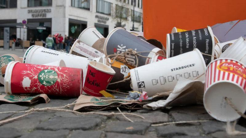 Pile of used coffee cups on the ground