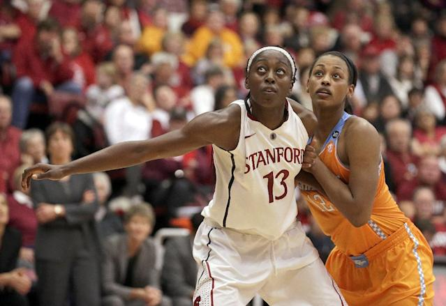 Stanford forward Chiney Ogwumike (13) battle for a rebound against Tennessee forward Bashaara Graves (12) during the first half of an NCAA college basketball game, Saturday, Dec. 21, 2013, in Stanford, Calif. (AP Photo/Tony Avelar)