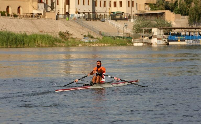 Mohammed Ryadh, training on the Tigris River in Baghdad, has been unable to see his French coach because of the coronavirus pandemic