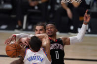 Oklahoma City Thunder's Danilo Gallinari, front, loses control of the ball to Houston Rockets' Russell Westbrook (0), right, as Steven Adams, rear, looks on during the second half of an NBA first-round playoff basketball game in Lake Buena Vista, Fla., Wednesday, Sept. 2, 2020. (AP Photo/Mark J. Terrill)