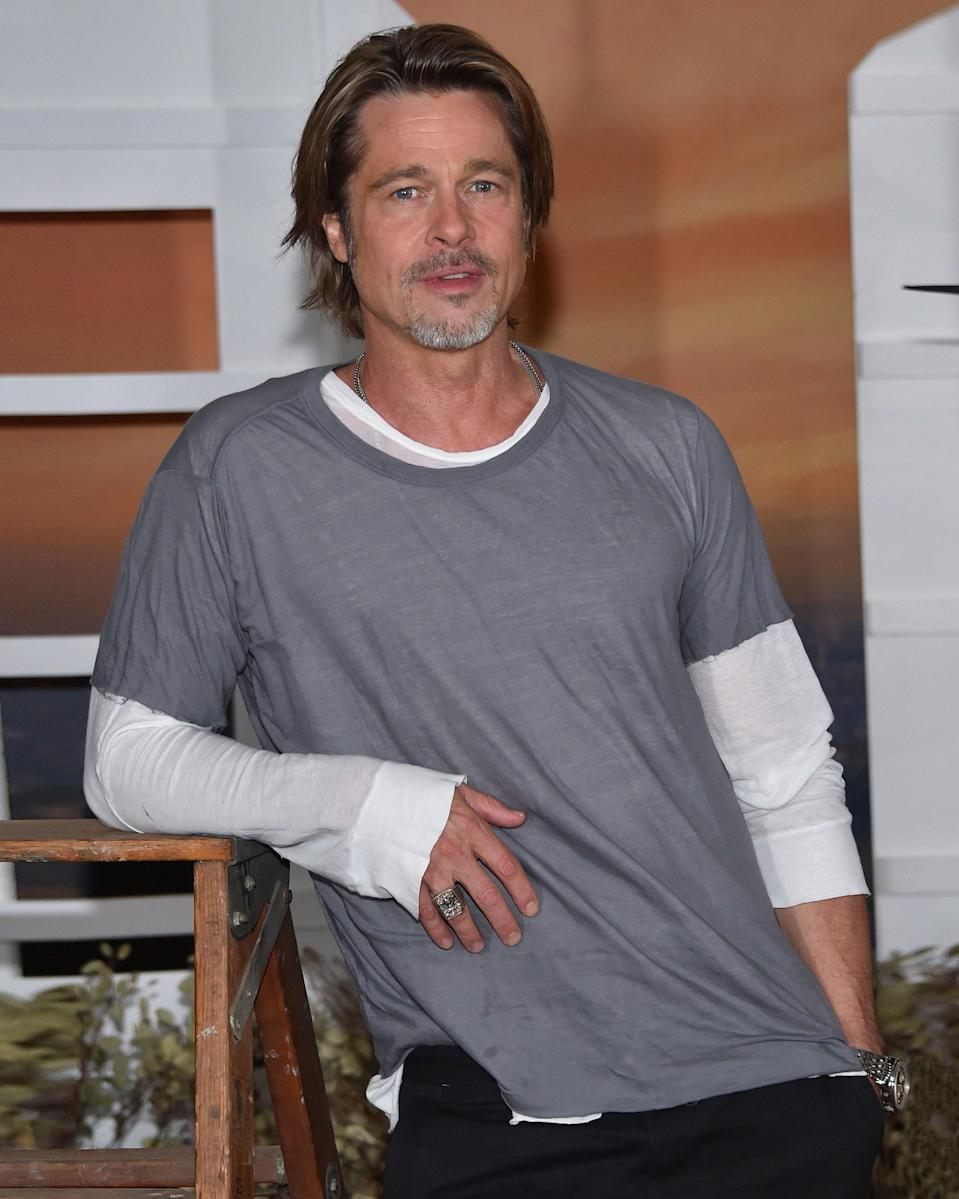 """<h1 class=""""title"""">July 12: Brad Pitt</h1> <div class=""""caption""""> In Brad Pitt's hands, the humble short-sleeve-over-long-sleeve look becomes a #BigFitoftheDay. </div> <cite class=""""credit"""">Getty Images</cite>"""