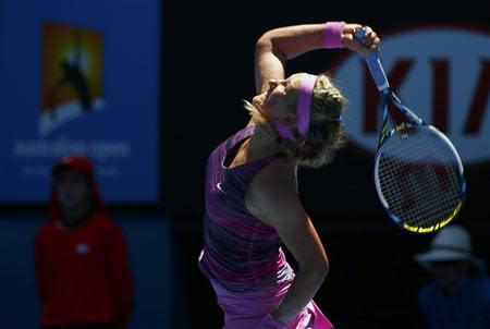 Victoria Azarenka of Belarus serves to Johanna Larsson of Sweden during their women's singles match at the Australian Open 2014 tennis tournament in Melbourne January 14, 2014. REUTERS/Petar Kujundzic