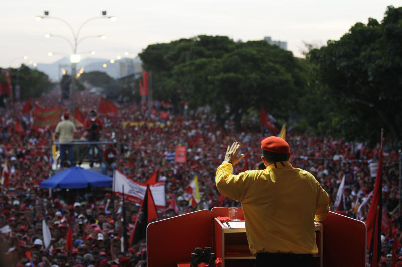 FILE - In this July 14, 2012 file photo, Venezuela's President Hugo Chavez speaks to supporters at a campaign rally in Barquisimeto, Venezuela. When he takes the stage at campaign rallies, Chavez stands alone. Under Venezuela's election system, presidential hopefuls don't choose running mates. The lack of a No. 2 leaves voters with a big unknown ahead of next month's presidential election and raises question about who in fact would take over were Chavez to win and leave office prematurely. (AP Photo/Ariana Cubillos,File)