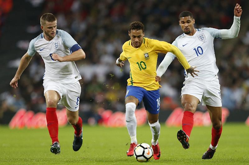 Brazil's striker Neymar (C) vies with England's midfielder Eric Dier (L) and midfielder Ruben Loftus-Cheek (R) during the international friendly football match November 14, 2017 (AFP Photo/Ian KINGTON)