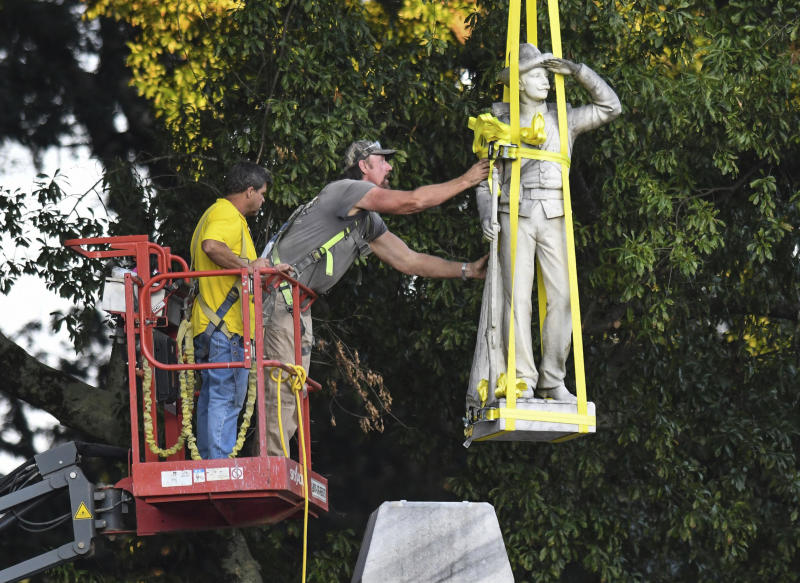 A Confederate statue is removed in the Circle at the University of Mississippi.