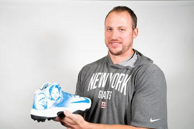 Nate Solder holding his Compassion Cleats for the NFL's My Cause My Cleats campaign.