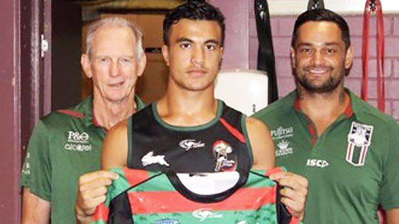 Joseph Suaalii is pictured in front of Wayne Bennett and John Sutton.