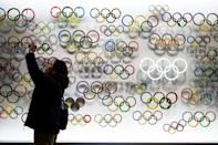 The outbreak of COVID-19 has cast a shadow over preparations for the Tokyo 2020 Olympics which open in July (AFP Photo/Philip FONG)