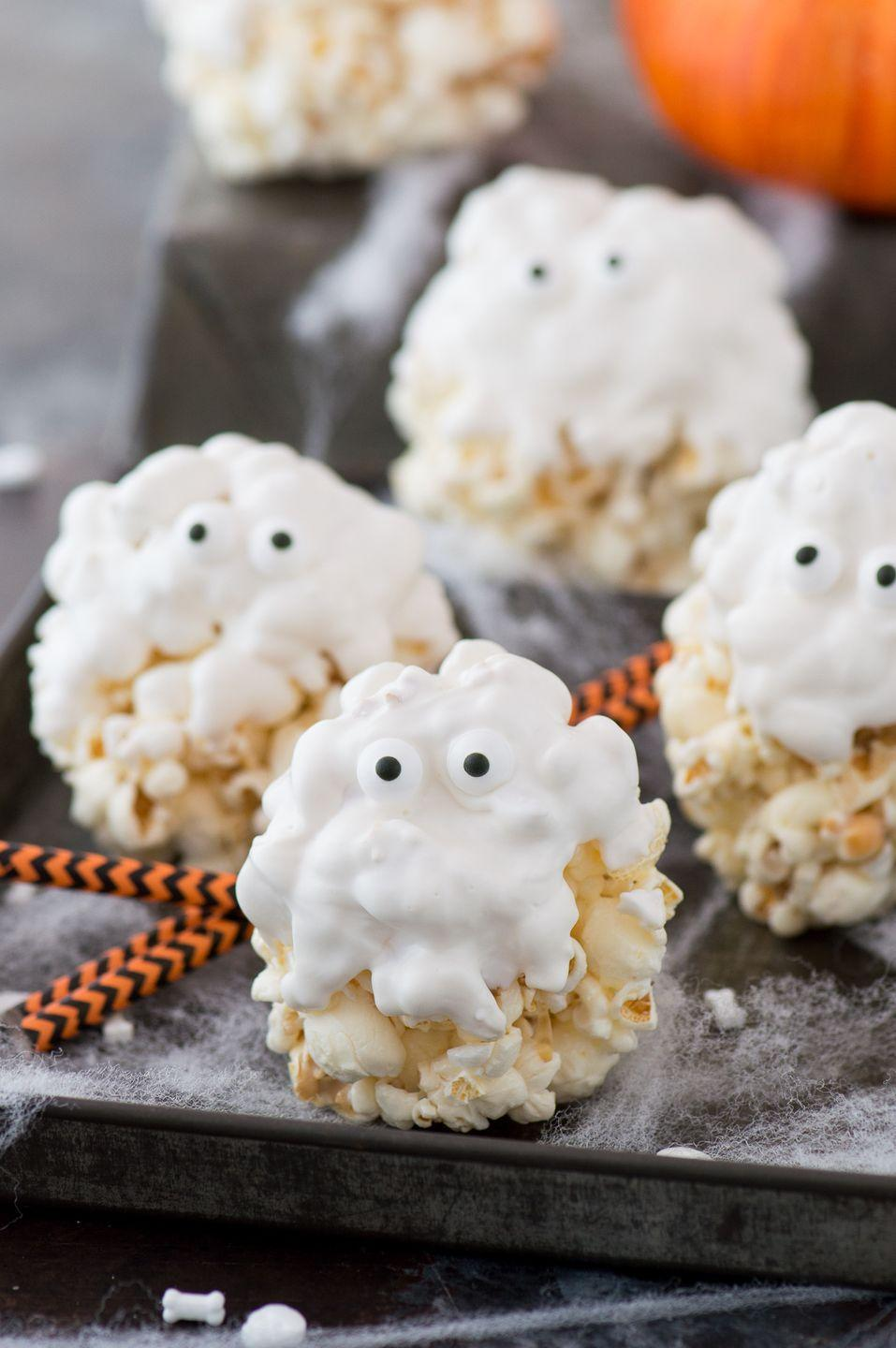"""<p>White candy melts make this five-ingredient treat look more ghostly, but you can use your favorite chocolate flavor.</p><p><strong>Get the recipe at <a href=""""https://thefirstyearblog.com/ghost-popcorn-balls/"""" rel=""""nofollow noopener"""" target=""""_blank"""" data-ylk=""""slk:The First Year"""" class=""""link rapid-noclick-resp"""">The First Year</a>.</strong> </p>"""