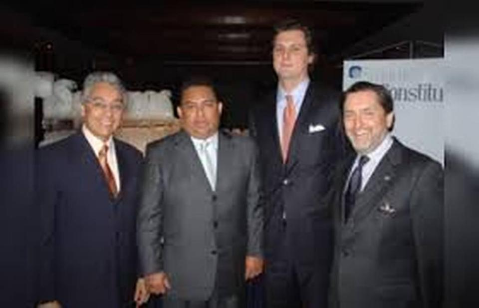 Justice Department officials told the Miami Herald they are building a case against bankers Luis Oberto Anselmi, second front right and his brother, Ignacio, far right.