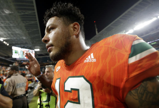 "Miami quarterback <a class=""link rapid-noclick-resp"" href=""/ncaaf/players/240751/"" data-ylk=""slk:Malik Rosier"">Malik Rosier</a> walks off the field after an NCAA college football game against Notre Dame, Saturday, Nov. 11, 2017, in Miami Gardens, Fla. Miami won 41-8. (AP Photo/Lynne Sladky)"