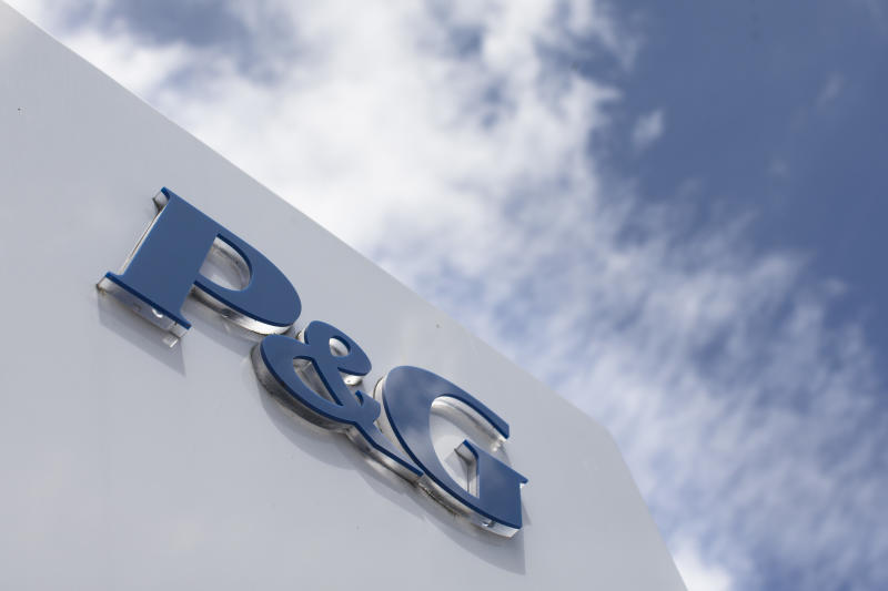 P&G reports flat 3Q profit, buys Merck unit