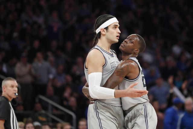 Georgetown forward Josh LeBlanc (23) restrains center Omer Yurtseven (44) after Yurtseven was called for a foul and objected to the call during the second half of the team's NCAA college basketball game against Duke in the 2K Empire Classic, Friday, Nov. 22, 2019 in New York. Duke won 81-73. (AP Photo/Kathy Willens)