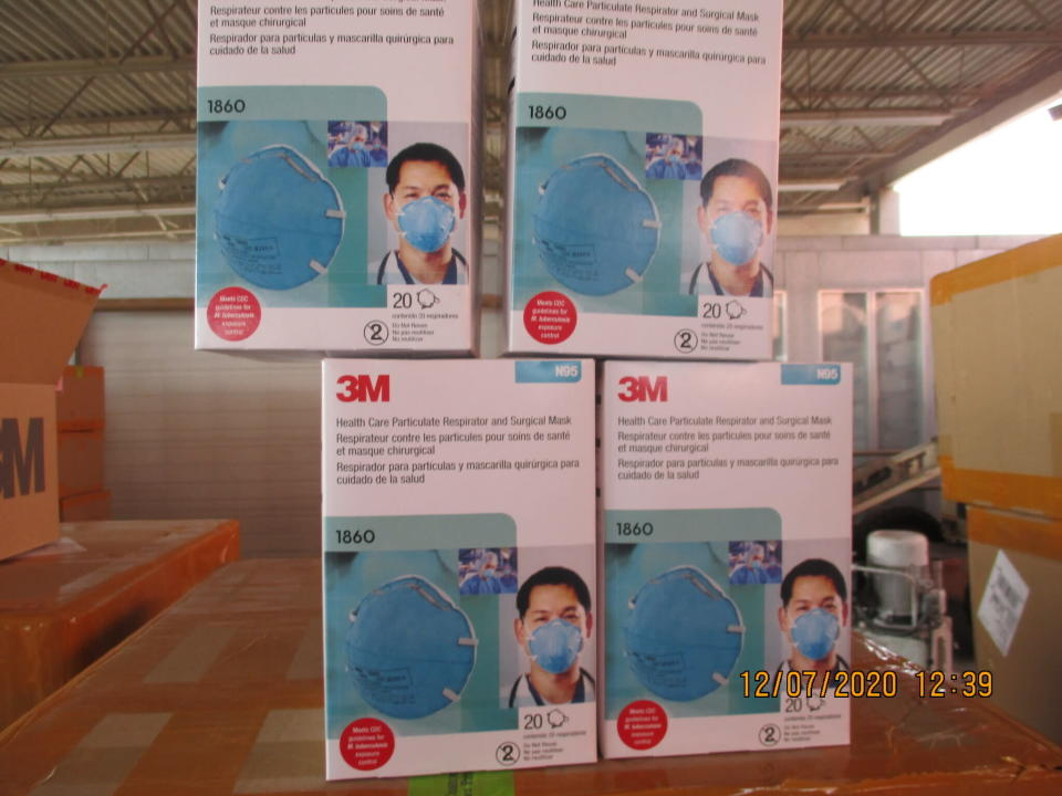 This December 2020 image provided by U.S. Immigration and Customs Enforcement (ICE) shows counterfeit N95 surgical masks that were seized by ICE and U.S. Customs and Border Protection. Federal investigators are probing a massive counterfeit N95 mask operation sold in at least five states to hospitals, medical facilities, and government agencies and expect the number to rise significantly in coming weeks. The fake 3M masks are at best a copyright violations and at worst unsafe fakes that put unknowing health care workers at grave risk for coronavirus. And they are becoming increasingly difficult to spot. (ICE via AP)
