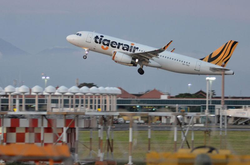 A Tiger Airways plane take-off from I Gusti Ngurah Rai airport in Denpasar