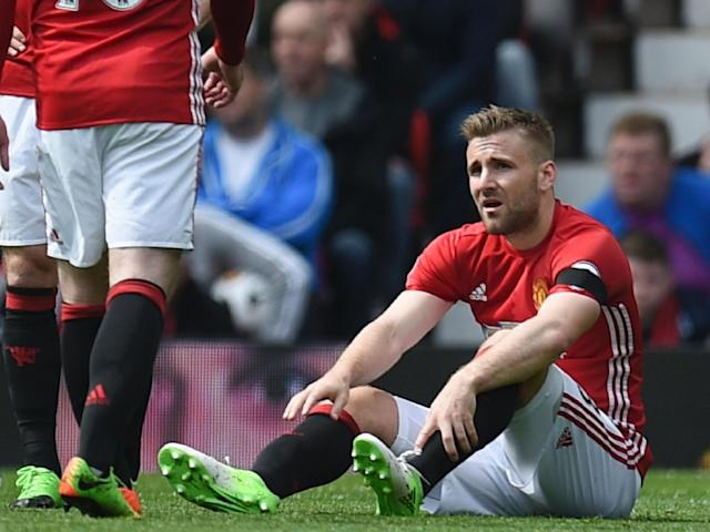 Shaw was taken off in the first-half with an ankle injury (AFP/Getty Images)