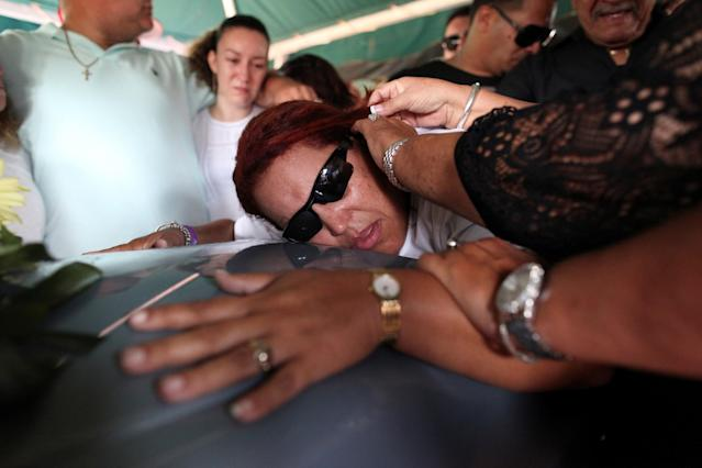 <p>Friends of Juan Carlos Nieves Rodriguez, one of the victims of the shooting at the Pulse night club in Orlando, Fla., outside the funeral parlor at his hometown of Caguas, Puerto Rico, June 20, 2016. (Reuters/Alvin Baez) </p>