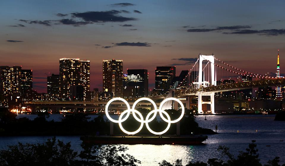 The Olympic Rings are seen in front of the skyline during sunset one night ahead of the official opening of the Tokyo 2020 Olympic Games in Tokyo, Japan, July 22, 2021.   REUTERS/Kai Pfaffenbach     TPX IMAGES OF THE DAY