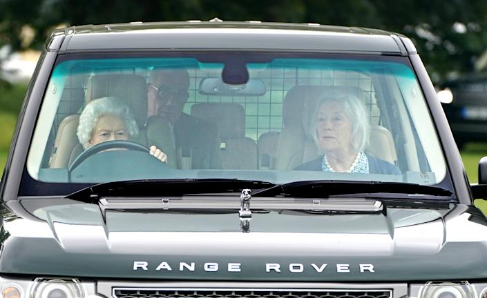 Queen Elizabeth II drives a Range Rover at the Royal Windsor Horse Show, Windsor. Picture date: Friday July 2, 2021. (Photo by Steve Parsons/PA Images via Getty Images)