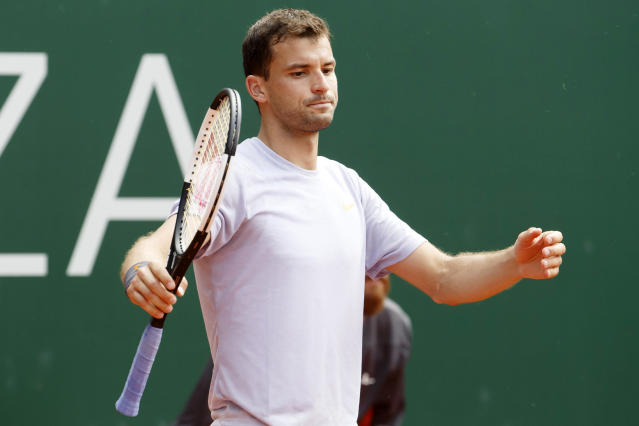 Grigor Dimitrov of Bulgaria after losing a set to Federico Delbonis, of Argentina during their first round match at the ATP 250 Geneva Open tournament in Geneva, Switzerland, Tuesday, May 21, 2019. (Salvatore Di Nolfi/Keystone via AP)