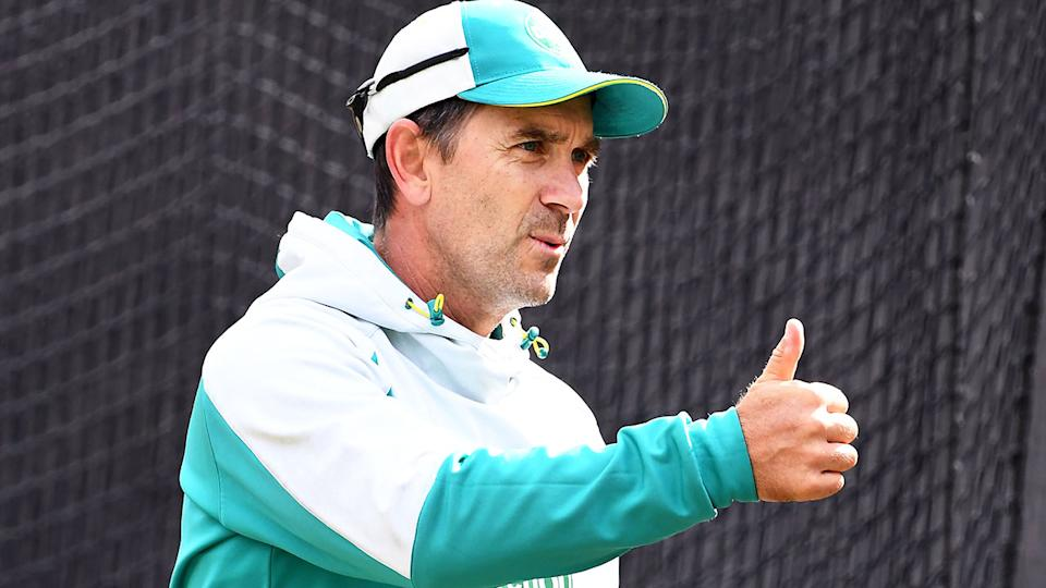 Pictured here, Australia coach Justin Langer gives a thumbs up during a training session.