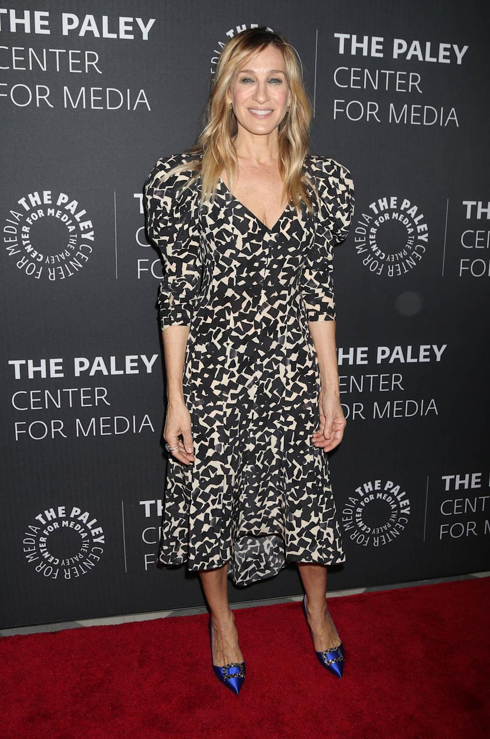 <p>The actress wore a printed dress with contrasting bold shoes for the screening of her TV show. <em>[Photo: Rex]</em> </p>