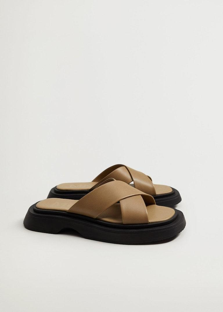 """Stay low-key with these lower-profile platform slides from Mango. The muted palette plays down the higher footbed, and they'll look just as good with your best athleisure gear as they would with an airy sundress. $80, Mango. <a href=""""https://shop.mango.com/us/women/shoes-flat-sandals/leather-sandals-with-straps_87055706.html?c=36"""" rel=""""nofollow noopener"""" target=""""_blank"""" data-ylk=""""slk:Get it now!"""" class=""""link rapid-noclick-resp"""">Get it now!</a>"""