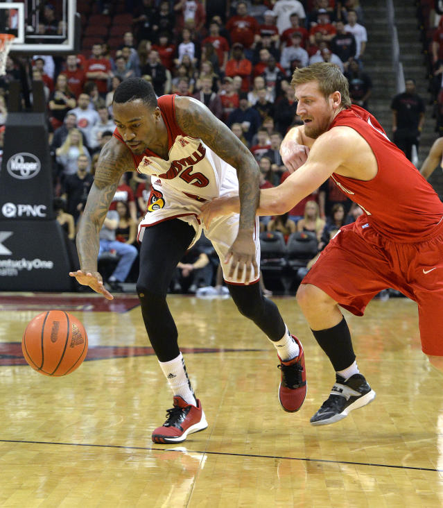 Hartford's Corban Wroe, right, grabs the jersey of Louisville's Kevin Ware as they battle for a loose ball during the second half of their NCAA college basketball game Tuesday, Nov. 19, 2013, in Louisville, Ky. Louisville defeated Hartford 87-48. (AP Photo/Timothy D. Easley)