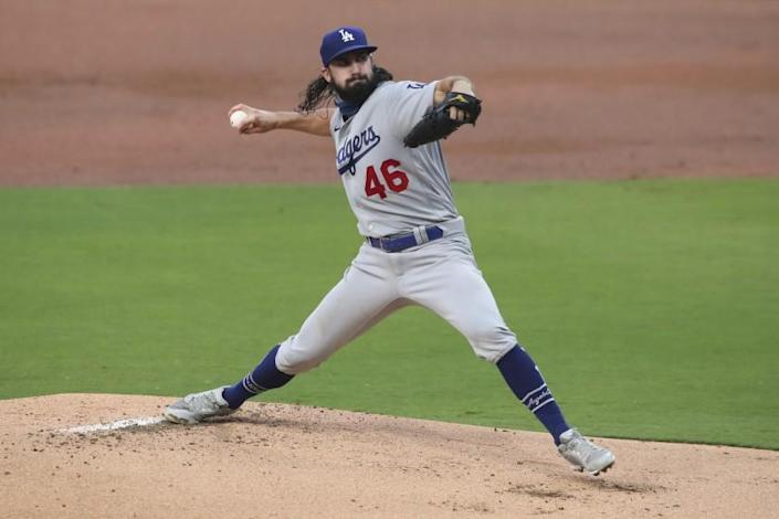 """Dodgers starter Tony Gonsolin allowed one run and four hits without a walk in seven innings against the San Diego Padres on Tuesday night. <span class=""""copyright"""">(Derrick Tuskan / Associated Press)</span>"""