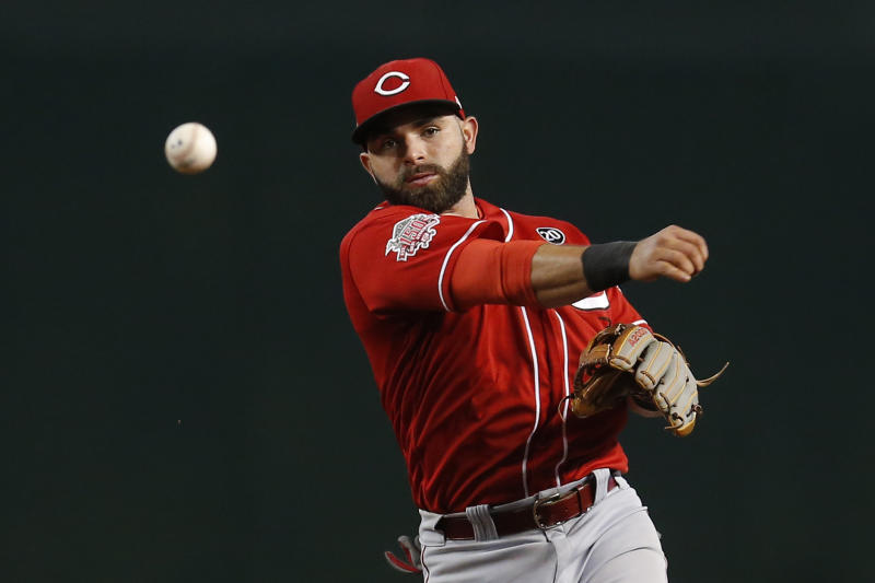 FILE - In this Sept. 15, 2019, file photo, Cincinnati Reds infielder Jos Peraza (9) throws the ball in the first inning during a baseball game against the Arizona Diamondbacks in Phoenix. People familiar with the negotiations tell The Associated Press on Friday, Dec. 13, 2019, that the Boston Red Sox have agreed to one-year contracts with free agent left-hander Martin Prez and shortstop Jos Peraza. The people spoke on the condition of anonymity because the deals had not yet been announced. (AP Photo/Rick Scuteri, File)