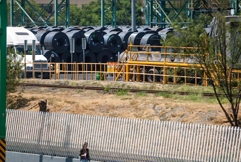 A woman walks past a steel plant in Monterrey, Mexico on August 27, 2018. Canada wants free trade with the ASEAN bloc, Trade Minister Jim Carr says after a breakthrough in US-Mexico talks on revamping NAFTA