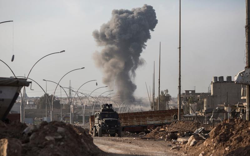 Smoke rises from an airstrike that targeted a car bomb in the neighbourhood of Mansour, on the southern edge of western Mosul on March 9, 2017 - Sam Tarling