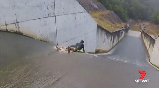Daredevils are using the dam as a type of waterslide. Source: 7 News