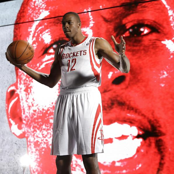 Houston Rockets center Dwight Howard poses in front of a video board during NBA basketball media day Friday, Sept. 27, 2013, in Houston. Howard signed with the Rockets in the offseason. (AP Photo/David J. Phillip)