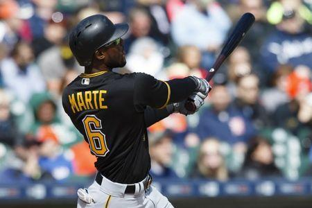 Apr 12, 2016; Detroit, MI, USA; Pittsburgh Pirates left fielder Starling Marte (6) hits a two run home run in the sixth inning against the Detroit Tigers at Comerica Park. Mandatory Credit: Rick Osentoski-USA TODAY Sports