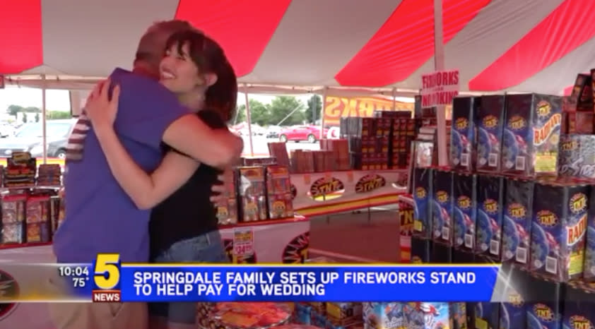 Bride-to-be Sarah Ashley hugs her dad, Heath Bryant, at the family's fireworks stand. (Photo: Courtesy of 5newsonline.com)