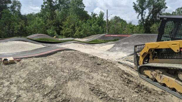 Despite some cyclists showing up at Windsor's new pump track in recent weeks, it hasn't officially opened to the public yet.  (Sanjay Maru/CBC - image credit)