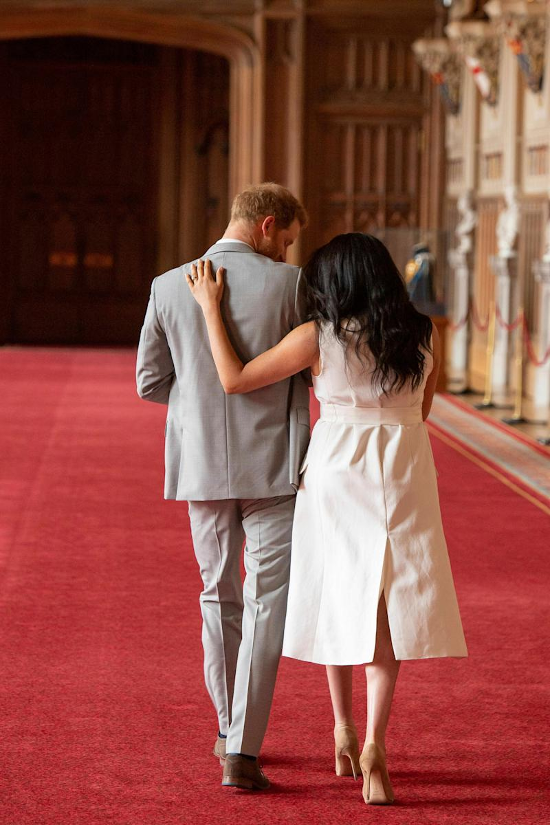 """Britain's Prince Harry and Meghan, Duchess of Sussex, leaves after a photocall with their newborn son, in St George's Hall at Windsor Castle, Windsor, south England, Wednesday May 8, 2019. Baby Sussex was born Monday at 5:26 a.m. (0426 GMT; 12:26 a.m. EDT) at an as-yet-undisclosed location. An overjoyed Harry said he and Meghan are """"thinking"""" about names. (Dominic Lipinski/Pool via AP)"""
