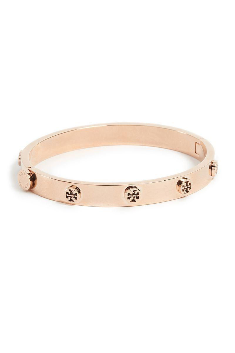 """<p><strong>Tory Burch</strong></p><p>amazon.com</p><p><strong>$128.00</strong></p><p><a href=""""https://www.amazon.com/dp/B01NCTGIZJ?tag=syn-yahoo-20&ascsubtag=%5Bartid%7C10056.g.36664390%5Bsrc%7Cyahoo-us"""" rel=""""nofollow noopener"""" target=""""_blank"""" data-ylk=""""slk:Shop Now"""" class=""""link rapid-noclick-resp"""">Shop Now</a></p><p>Studded with Tory Burch's signature logo, this bracelet looks great stacked or solo.</p>"""