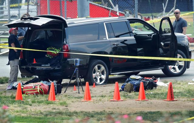 <p>Investigators survey a black SUV with a flat tire and a hole on its windshield outside the Eugene Simpson Stadium Park where a shooting had happened June 14, 2017 in Alexandria, Va. (Photo: Alex Wong/Getty Images) </p>