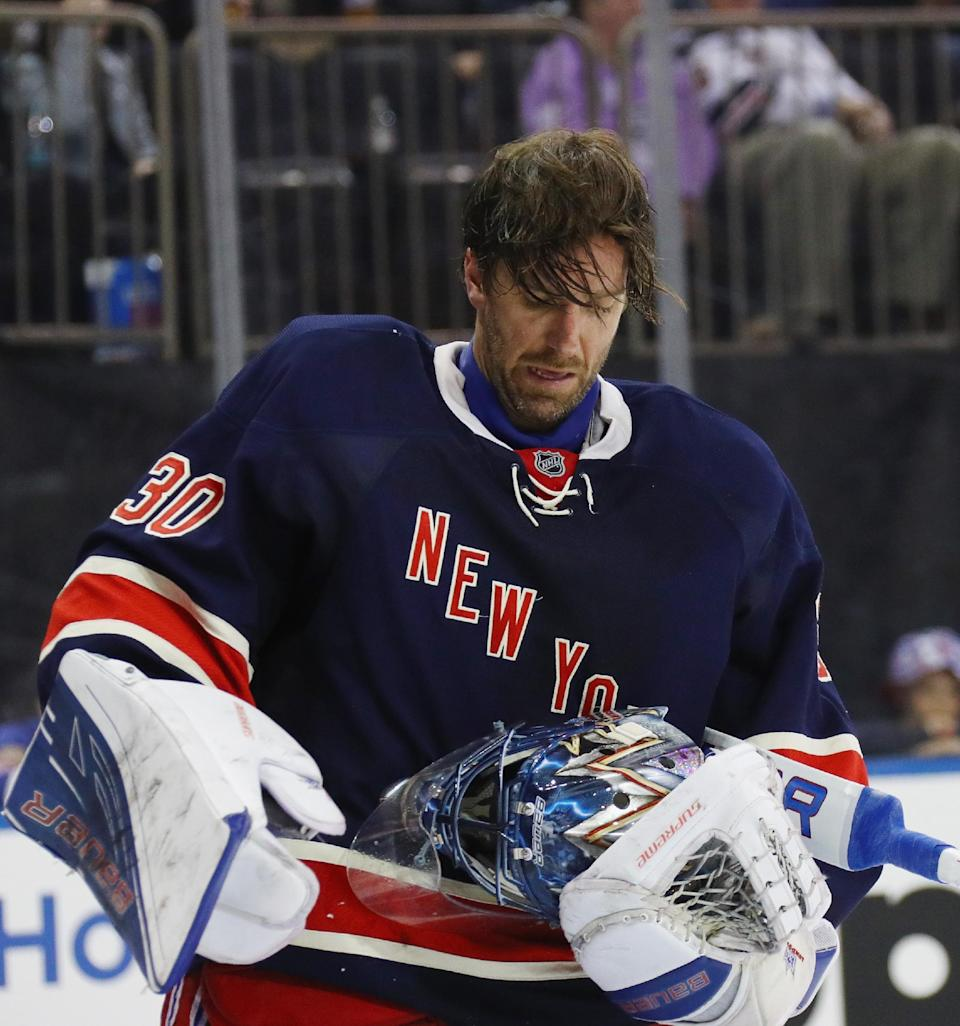NEW YORK, NY - MARCH 13:  Henrik Lundqvist #30 of the New York Rangers looks at his mask after being hit by a shot by Carl Hagelin #62 during the third period at Madison Square Garden on March 13, 2016 in New York City. The Penguins defeated the Rangers 4-2.  (Photo by Bruce Bennett/Getty Images)