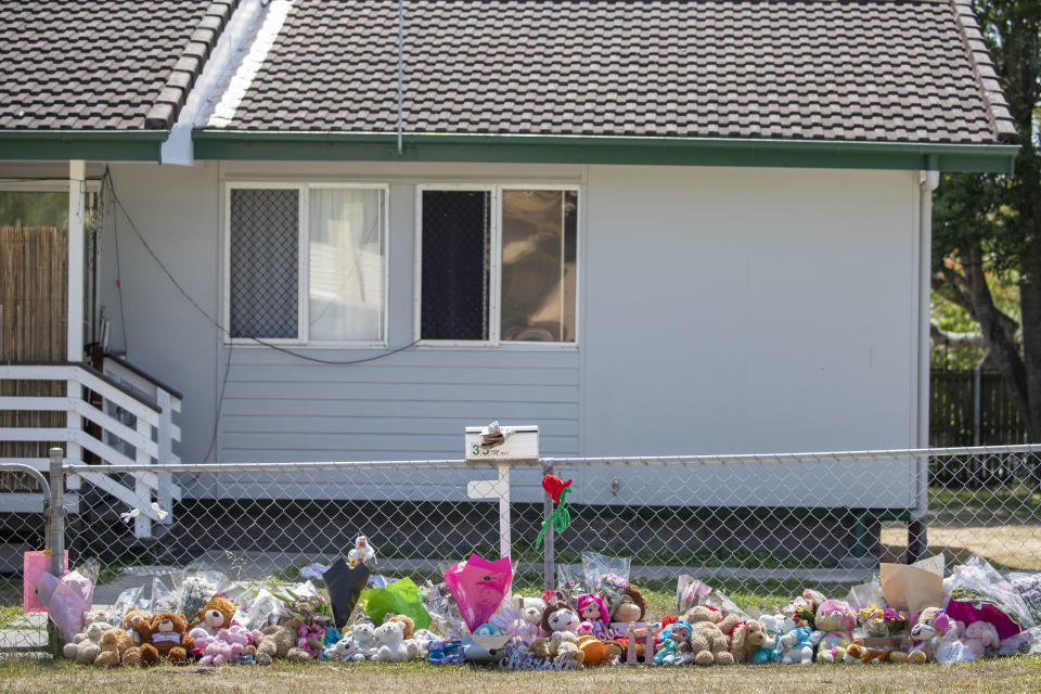 Tributes are seen at a house on Logan Reserve Road, Waterford West in Brisbane where the toddlers were found dead. Source: AAP