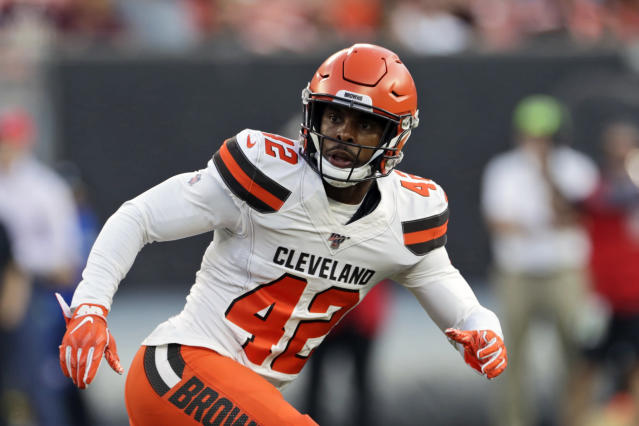 FILE - In this Aug. 8, 2019, file photo, Cleveland Browns strong safety Morgan Burnett runs a route during the first half of an NFL preseason football game against the Washington Redskins, in Cleveland. The Browns could be missing several starters Sunday night when they face the defending NFC champion Los Angeles Rams. Tight end David Njoku (wrist), linebacker Christian Kirksey (chest), right tackle Chris Hubbard (foot) and safeties Damarious Randall (concussion) and Morgan Burnett (leg) missed practice Thursday, Sept. 19, 2019. (AP Photo/Ron Schwane, File)