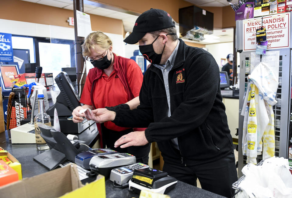 Muhlenberg, PA - March 18: Redner's Quick Shoppe employee Julie Zezenski and  Manager Pete Ostrowski work behind the counter at the Redner's Quick Shoppe on Tuckerton Road in Muhlenberg township Thursday afternoon March 18, 2021. (Photo by Ben Hasty/MediaNews Group/Reading Eagle via Getty Images)