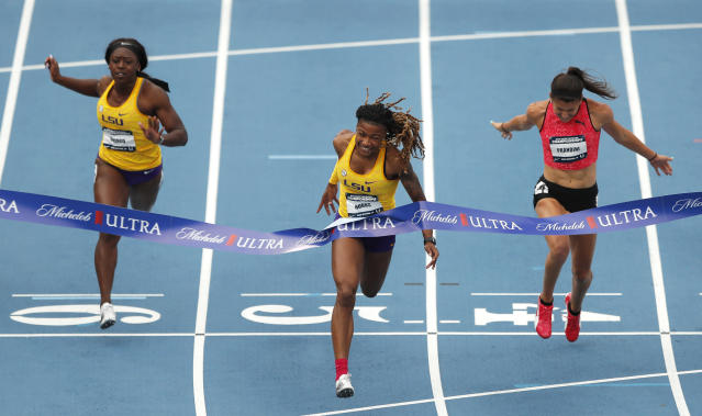 Aleia Hobbs, center, beats Mikiah Brisco, left, and Jenna Prandini to the finish line to win the women's 100 meters at the U.S. Championships athletics meet Friday, June 22, 2018, in Des Moines, Iowa. (AP Photo/Charlie Neibergall)