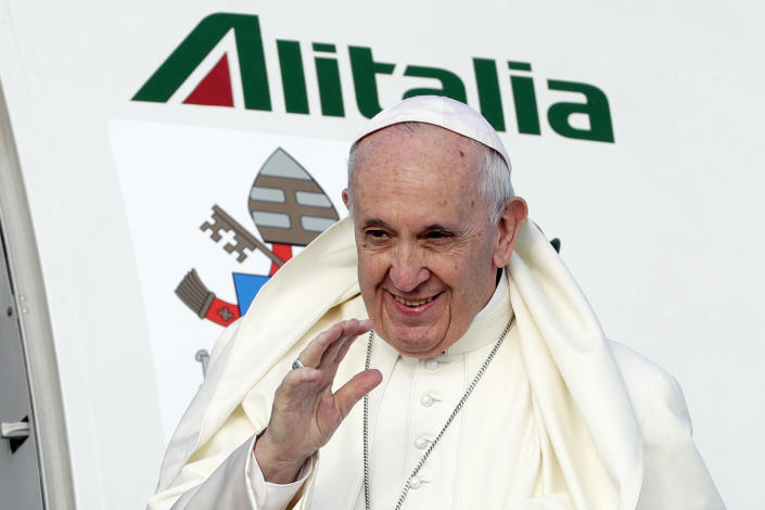Pope Francis waves as he boards an airplane at Rome's Fiumicino international airport, Saturday, Aug. 25, 2018. The pontiff is traveling to Ireland for a two-day visit on the occasion of the 2018 World Meeting of Families. (AP Photo/Andrew Medichini)