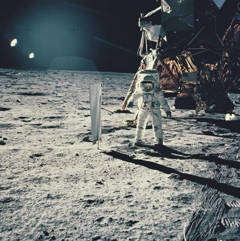 Lunar Module Pilot Edwin 'Buzz' Aldrin standing next to the Solar Wind Composition experiment, part of the Early Apollo Scientific Experiments Package (EASAP), at Tranquility Base on the surface of the Moon, during NASA's Apollo 11 lunar landing mission, July 1969.